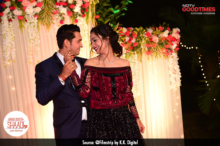 As is obvious in their eyes, Divya and Vaibhav express their love for each other while swinging to the sound of music, as their friends and family applaud.