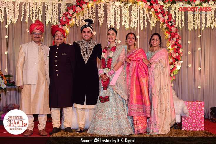 As two families become one, Vaibhav and Divya strike a pose with their parents.