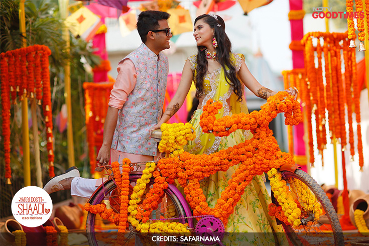 Mukul is quite the sport and doesn't mind a woman taking the lead. So he lets Megha take charge of the decorated bike while he plays the smitten girl leaning in to her man. Don't miss the leg!