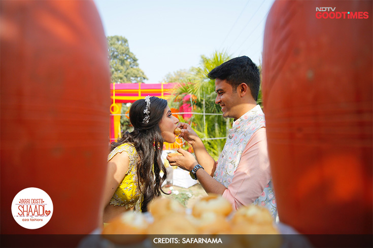 Making the most of their wedding photographer's idea to catch them eating pani puri in a photograph, Megha and Mayank deliver this candid shot.