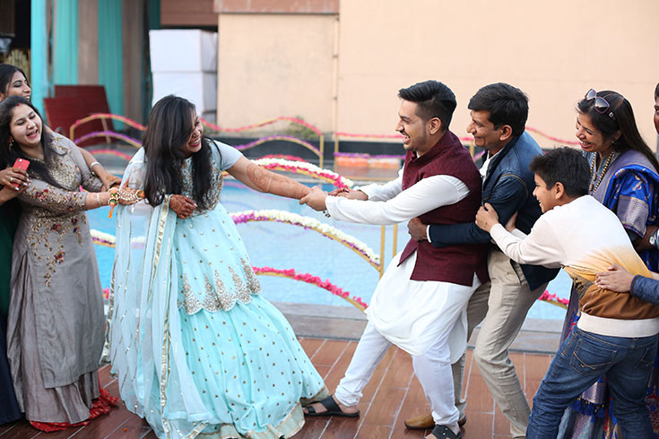 With so many close friends and family members present at their mehendi function, a tug of war seems like just the photograph Hitesh and Parul need to make their wedding album truly memorable