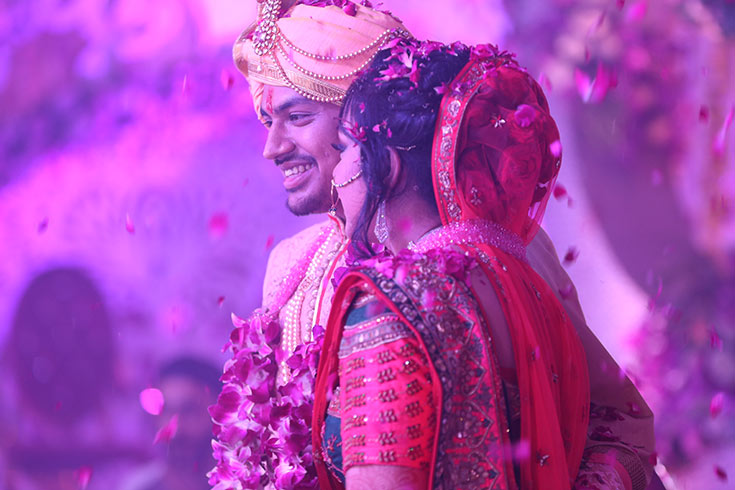 And finally with the varmala exchange and a showering of blessings disguised as flowers, Hitesh and Parul are wedded.