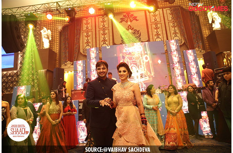 Tarni and Shivam leave everyone admiring them as they stand on the stage, wearing their glamorous Aza outfits.