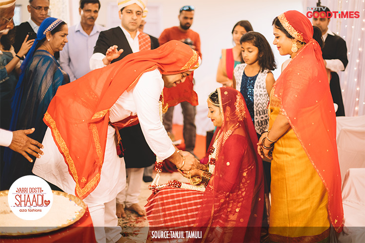 At the end of the ceremony, Vikram stands in front of Jahnavi and offers her a sip of milk and gives her a small bag that contains one gold, one silver and one copper coin. This is supposed to signify his sharing of all his wealth with his bride.