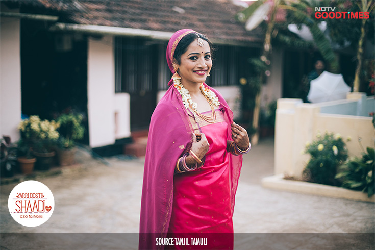 On the eve of the wedding, Jahnavi wears her sari in the traditional Kodava way before heading out for the ceremony.