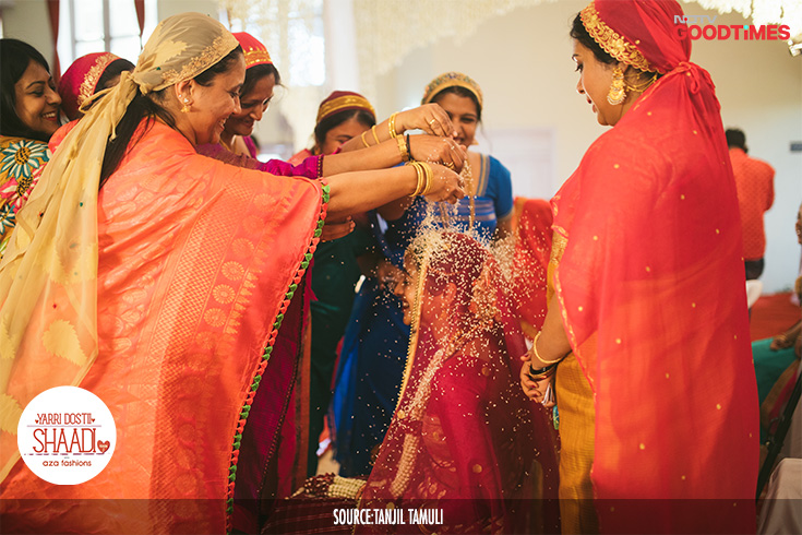 "Jahnavi is showered with rice during the ""Dampathi Muurtha"". All the ladies of the family bless the couple and shower them with rice for good luck and prosperity."